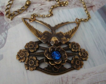 Wings, Jewel and Peace Necklace, Sapphire Blue Rhinestone, Flower Petal Setting