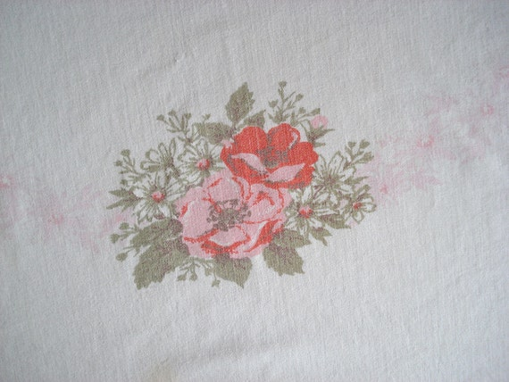 White cotton tablecloth with pink and orange flowers