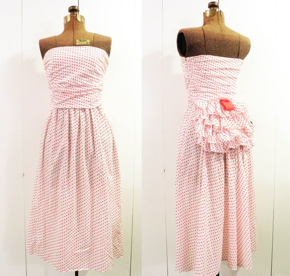 vintage rockabilly dress . red and white with a ruffle bustle . 1950s polka dots . size small