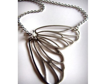 Fluttering Hinged Moth Wings Necklace in Matte Silver also available in Matte Gold