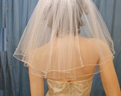 Shoulder length Flyaway bridal veil   2 Tier   Full Gathered style with accents of Pearls and Swarovski Rhinestones.