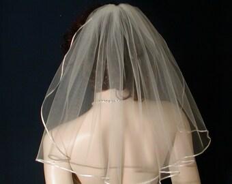 1 tier Shoulder length Flyaway Bridal Veil trimmed with a tiny,  delicate Satin Ribbon