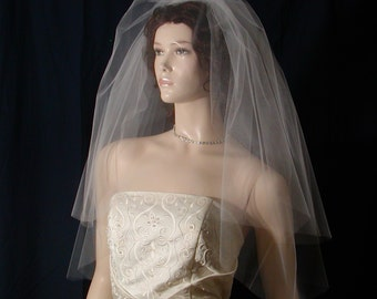 Classic Elegance in a 2 tier Elbow length Wedding veil with a super sheer plain cut edge