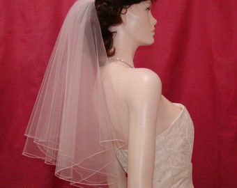 Elbow length Circular Cut 2 tier Bridal Veil finished with a delicate Pencil Edge