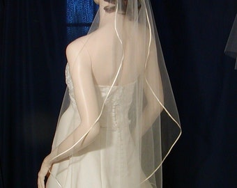 Satin Ribbon trimmed cascading style bridal veil available in Elbow to Royal length too !