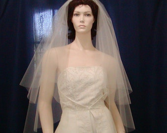 2 Tier fingertip length  Circle Cut Bridal Veil featuring a sheer plain cut edge