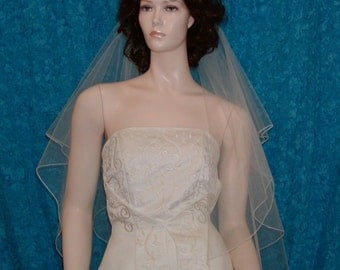 wedding veil  2 Tier Fingertip Center Gathered finished with a delicate pencil edge.