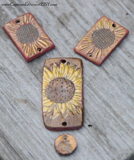 A set of 4 pottery sunflower beads