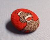 brooch / pin .sock monkey 2 - red . to benefit Operation Sock Monkey .