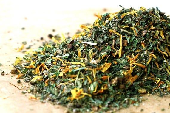 a dandelion nettle herbal tea blend . loose leaf