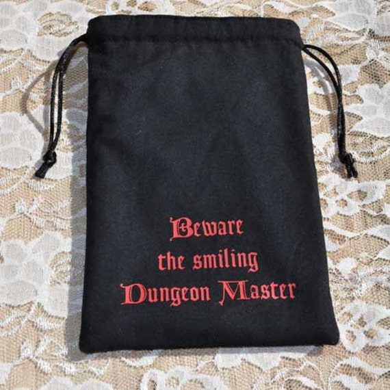 Dungeons and Dragons game dice Beware Smiling DM bag