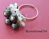 Opposites Attract- big magnetic black beads and dainty pretty white glass beads on adjustable silver band