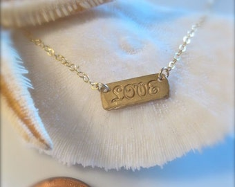 A Little Horizontal LOVE Necklace in Gold