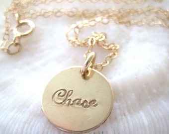 A Single Gold Disc Necklace Personalized in Script