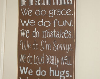 """In this home... Distressed Wood Sign 11.25"""" x 24"""""""
