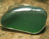 Sterling silver and large, dark green sea glass ring