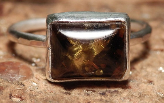 Sterling silver and honeyed green amber ring