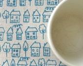 avenue - hand screenprinted fabric in sky blue on oatmeal