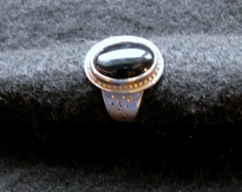 Black onyx and handforged sterling silver ring  in size 7.5