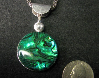 30 mm paua shell and sterling silver pendant with hand hammered bail