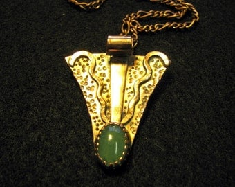 Copper pendant with clear green stone on a copper chain