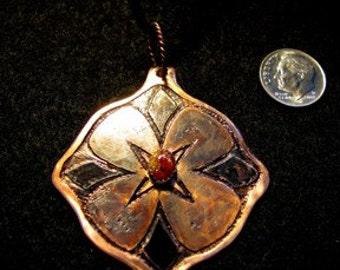 Etched copper flower motif necklace