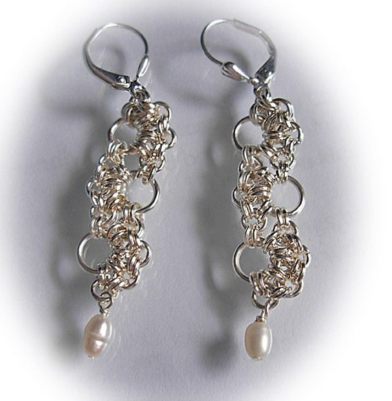 Ladder to luck sterling silver earrings with feshwater white pearls.