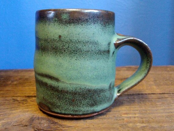 stoneware mug in rich, earthy green with copper accents