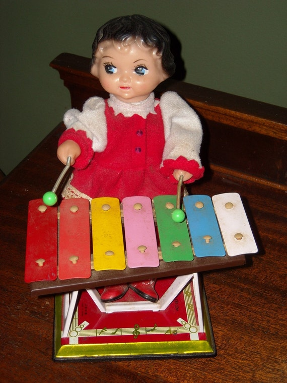 Wind Up Tin Toy Girl Playing Xylophone