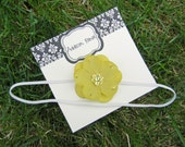 baby headband - Small moss green flower attached to a thin white elastic headband