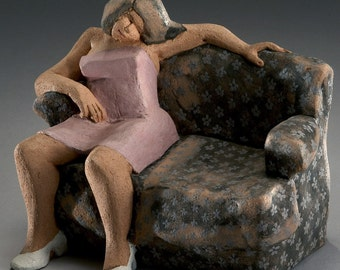 Woman on Worn Sofa
