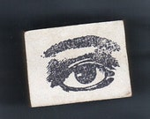 PIF-UNKNOWN MAKER WOOD MOUNT RUBBER STAMP OF A SINGLE OPEN EYE