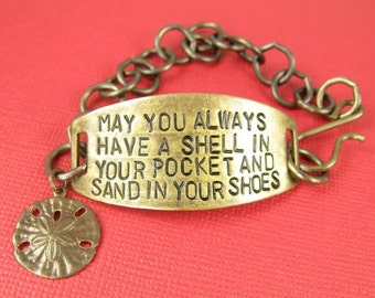 May you always have a shell in your pocket and sand in your shoes hand stamped brass bracelet