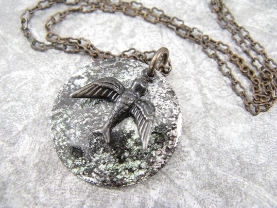 Black and silver hand painted pendant with soaring bird charm - necklace