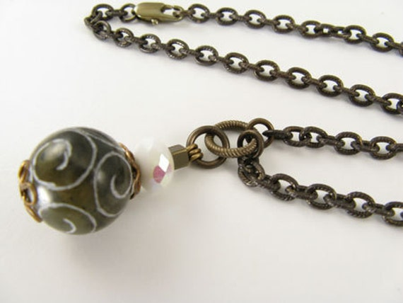 Brown with white swirls Glass bead on brass chain Necklace