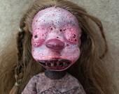 Creepy zombie doll