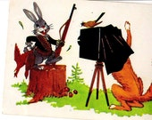 Russian vintage postcard  Illustration of Hunter Bunny holding his bird while fox photographer takes his picture USSR