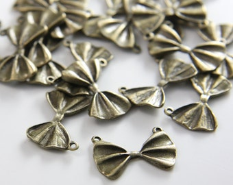 20pcs Antique Brass Tone Base Metal Charms-Bow 21x14mm (26455Y-H-31B)