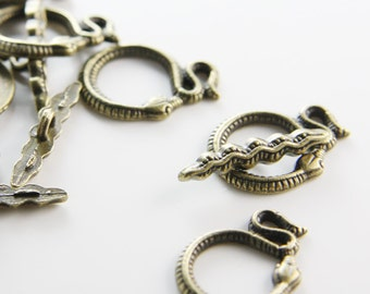 12 Sets Antique Brass Tone Base Metal Toggle Clasps  (8498Y-K-228)