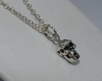 small skull pendant cast in sterling silver