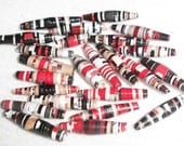 black, white, red and tan hand rolled paper beads