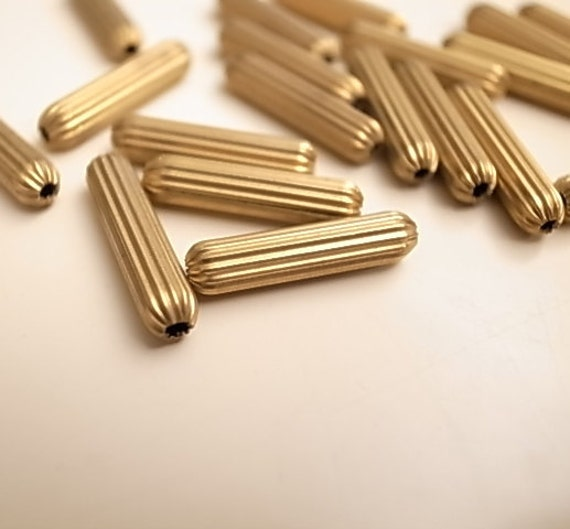 12 Vintage brass beads small size 18x3mm  crimp texture with hole through