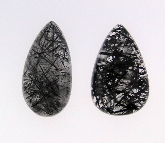 2 Black Rutilated Quartz pear cabochons, 57 carats total weight                           069-13-034
