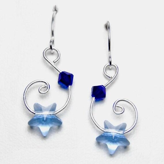 Light Sapphire Swarovski Star Crystal Earrings... Very unique