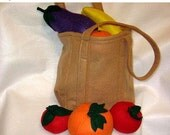 End of Year Sale Play Pretend felt food set includes eco friendly shopping bag, 7 fruits and vegetables, plus 3 slices of fruit.