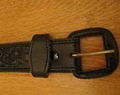 Black vintage tooled leather belt