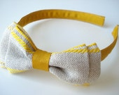 Double linen and mustard bow in a headband