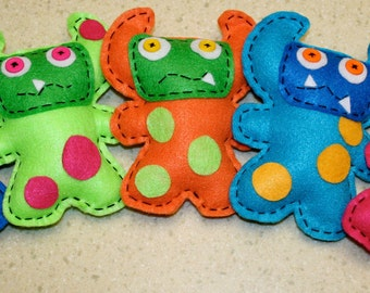 Group of 5 horned mini monster plush party favors made from recycled felt in bright and neon colors