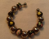 Black with Pink & Yellow Flowers and Silver Bangle Style Bracelet (B297)
