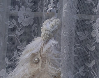 Exquisite Ivory Peacock with embellishments